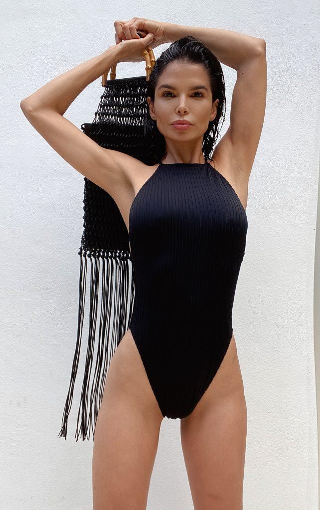 Fashion Influencer Victoria Barbara wearing Black Swimsuit