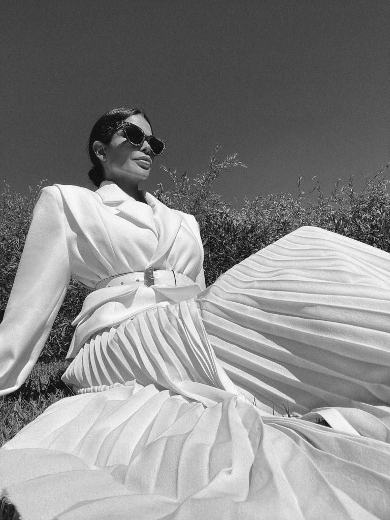 Fashion Influencer Victoria Barbara wearing Givenchy belt and Gia Studios White Blazer & Skirt