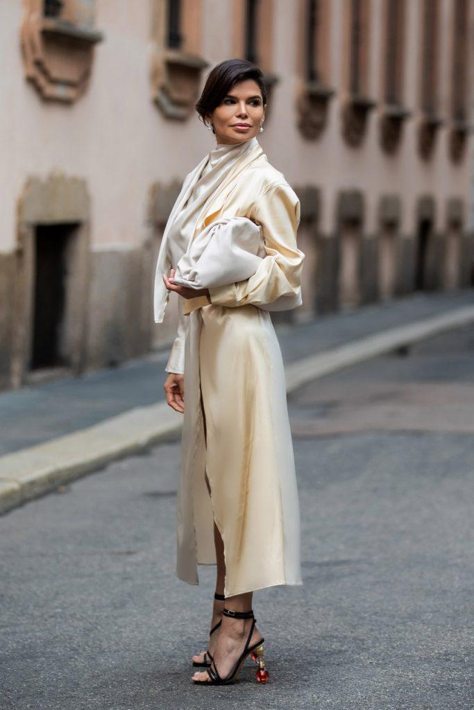 Victoria Barbara Street Style holding Bottega Veneta Pouch