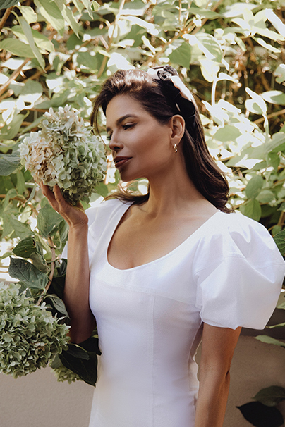 Victoria Barbara in Khaite White Dress in Garden