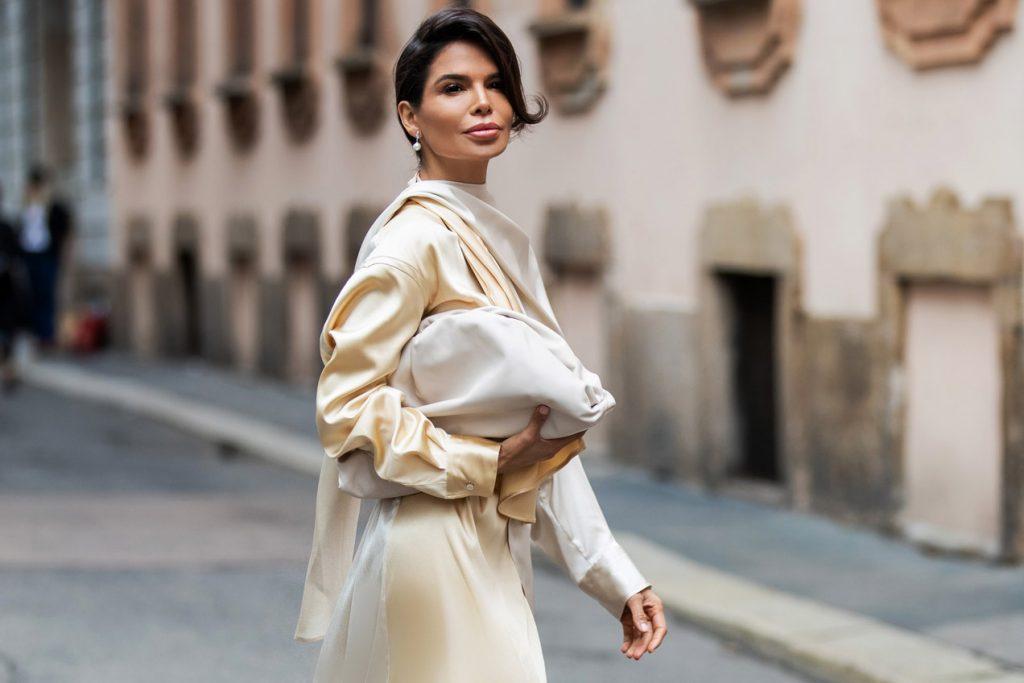 Victoria Barbara Street Style holding Bottega Veneta Women's Pouch in Mist